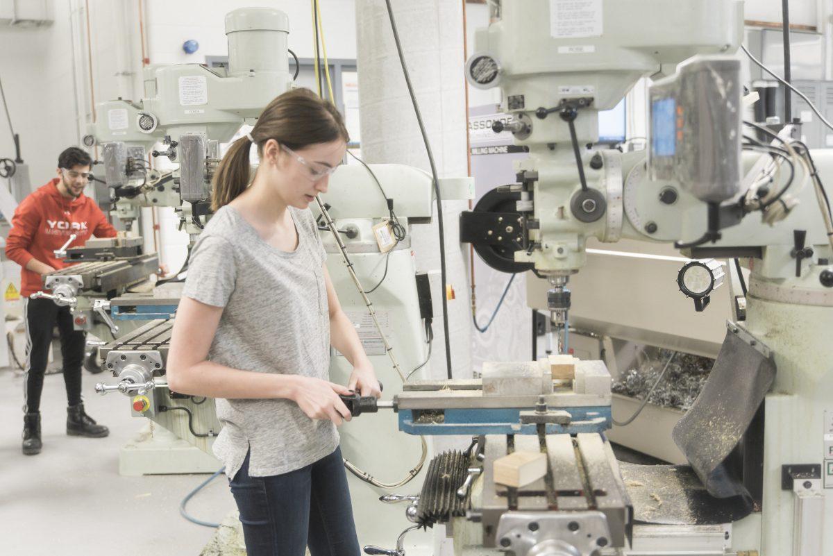 Students work in machine lab