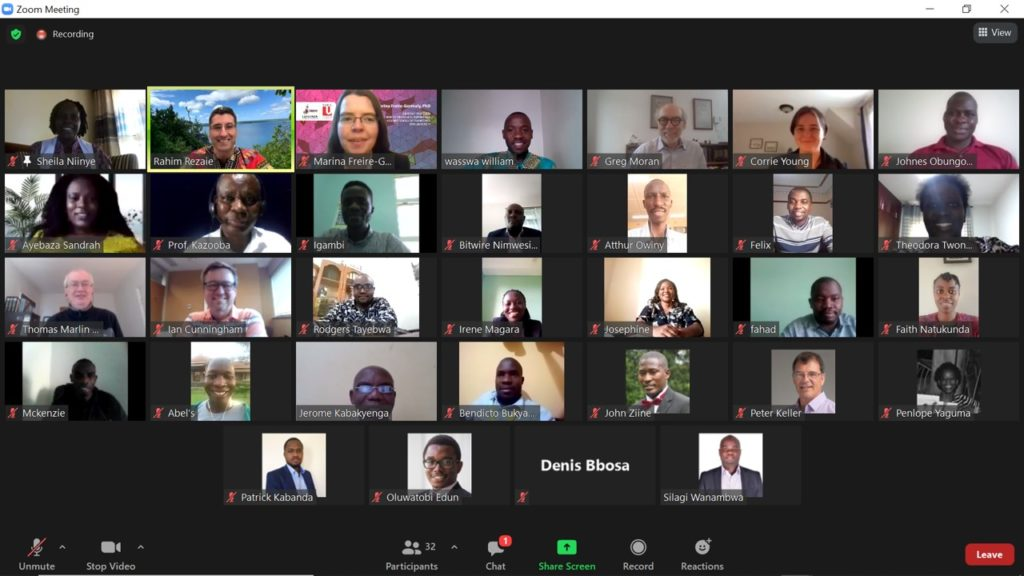 A computer screen depicts people in a zoom meeting