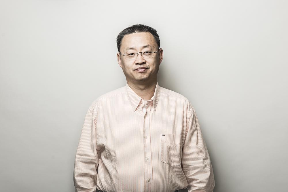 Headshot of Professor Jinjun Shan