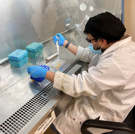 Dr. Kumar works in the lab