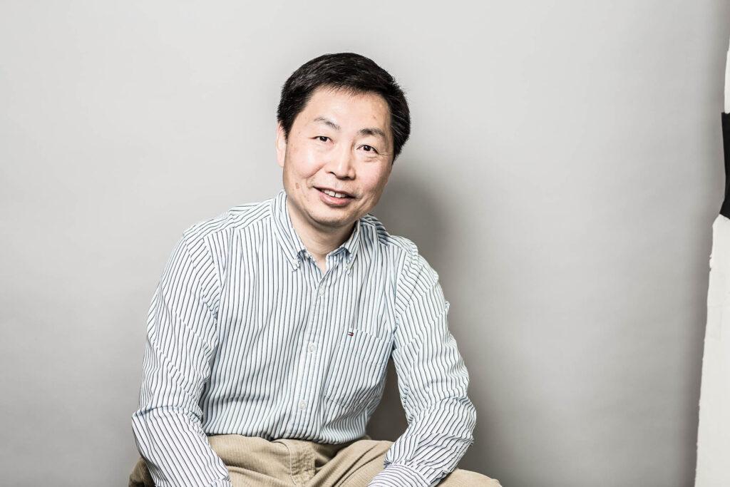 Headshot of professor Zheng Hong (George) Zhu