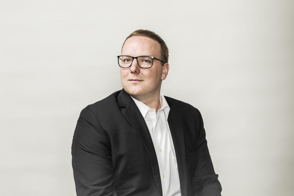 Headshot of professor Ryan Orszulik