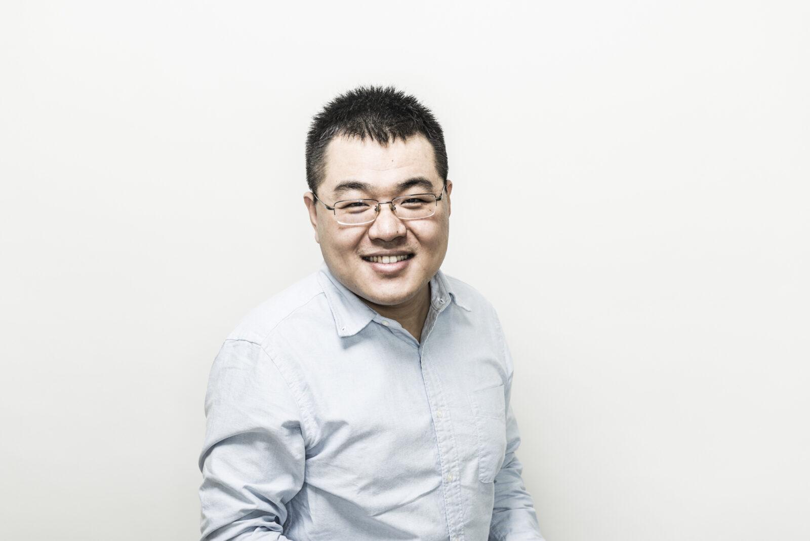 Headshot of professor Zheng Ming (Jack) Jiang