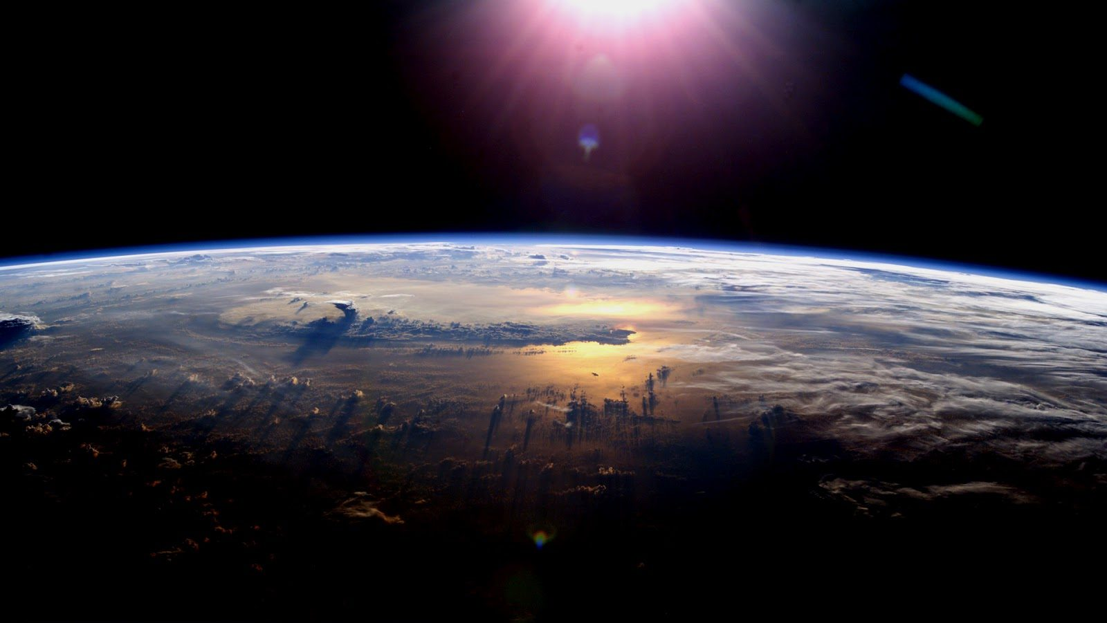 Shot of earth and the sun from space
