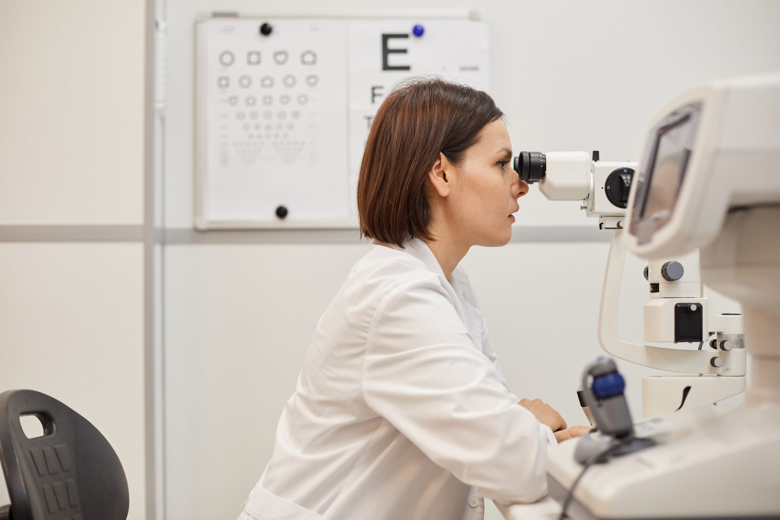 Female Ophthalmologist Using Vision Test Equipment
