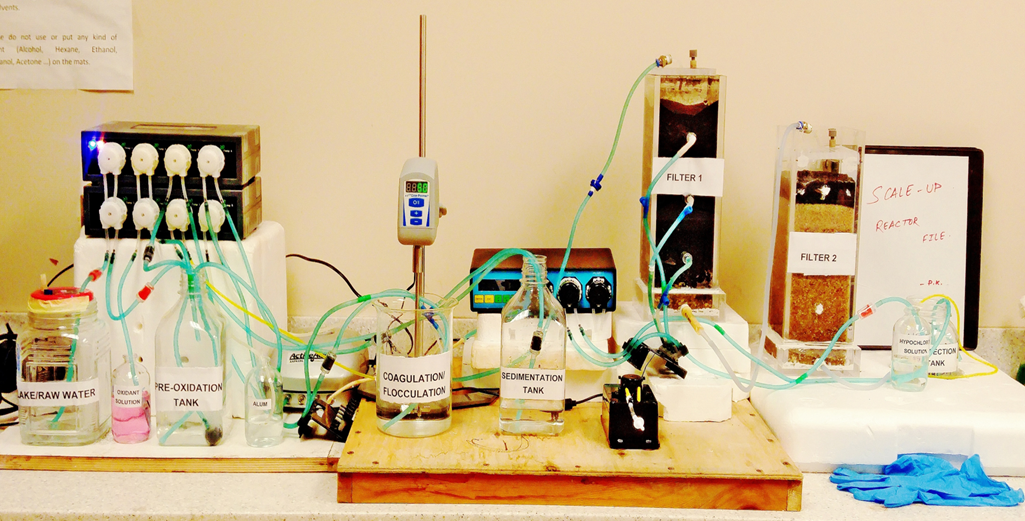 Image of a filtration unit. tubes connected to various jars and devices.
