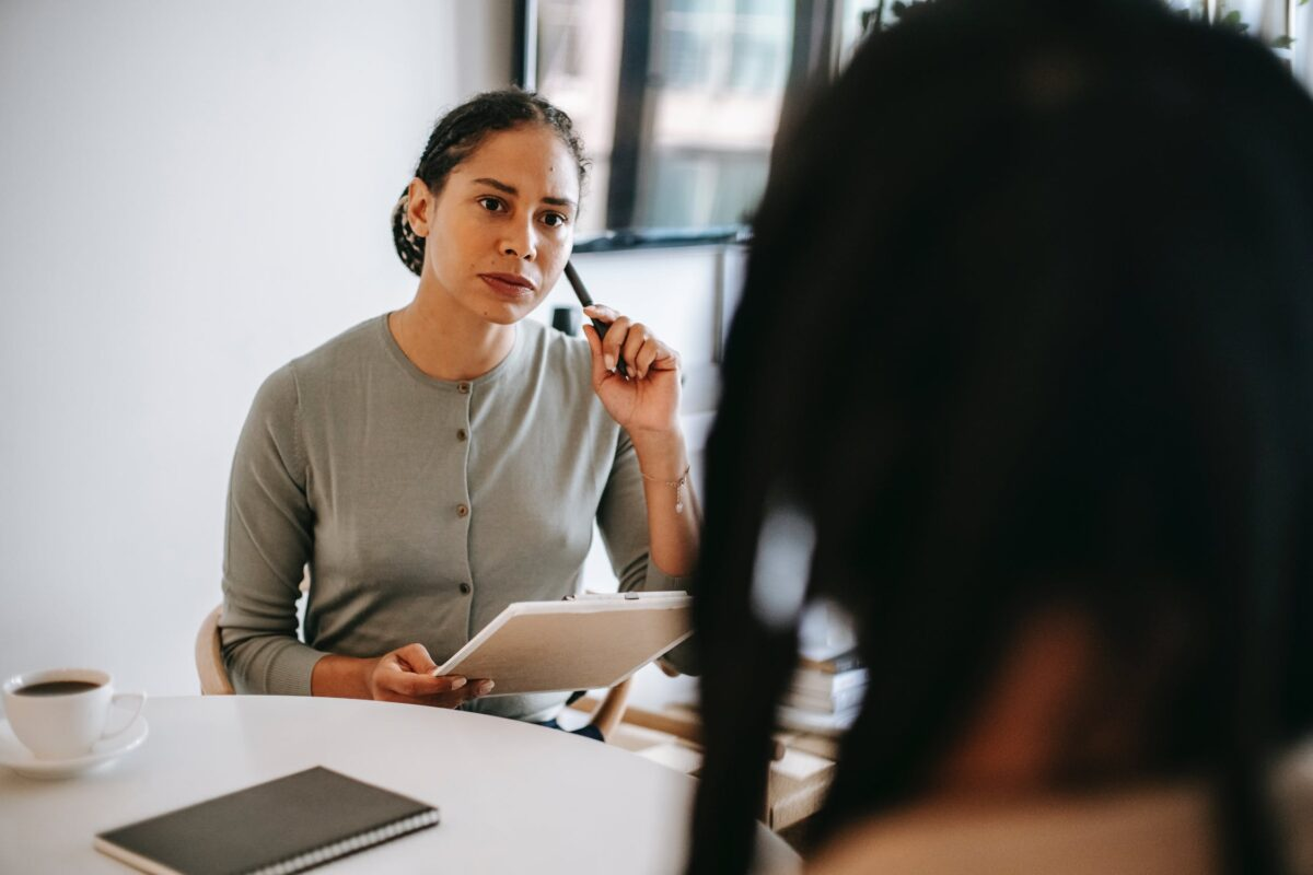 Counsellor listens to client