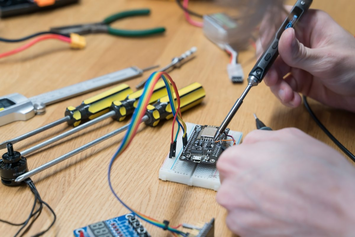 Person works on electronics
