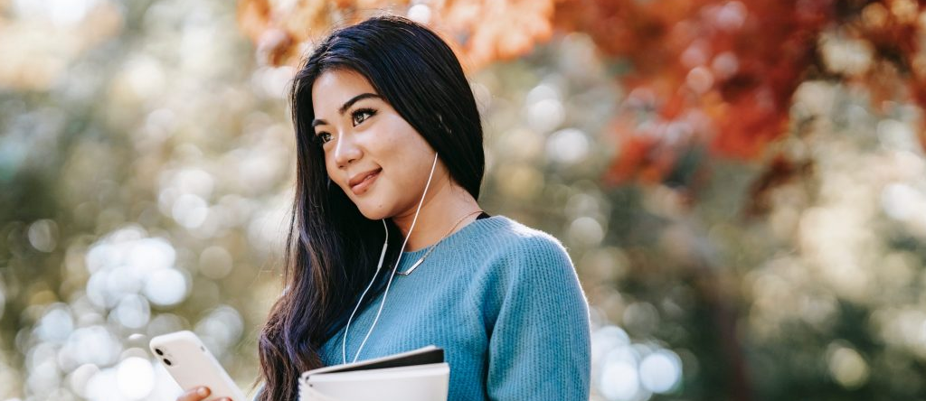 Smiling student walking outside
